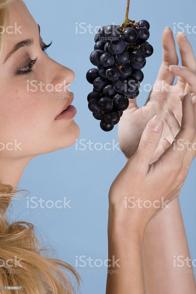 Blond woman with grapes royalty-free stock photo