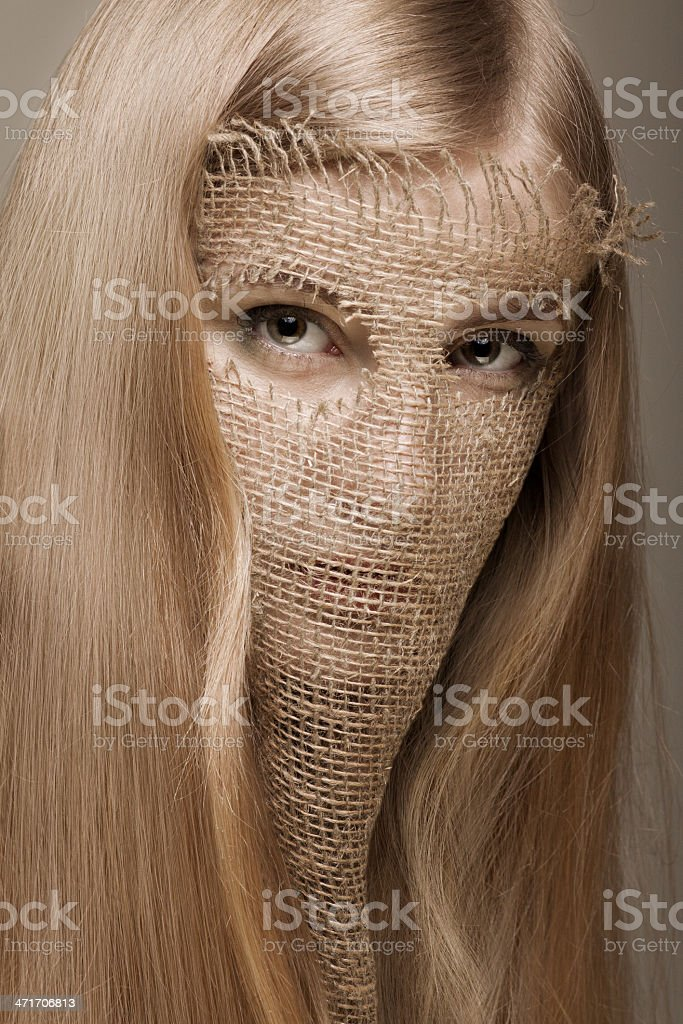 blond woman with gunny mask royalty-free stock photo