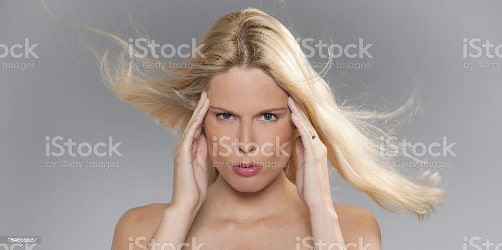 blond woman with headache royalty-free stock photo