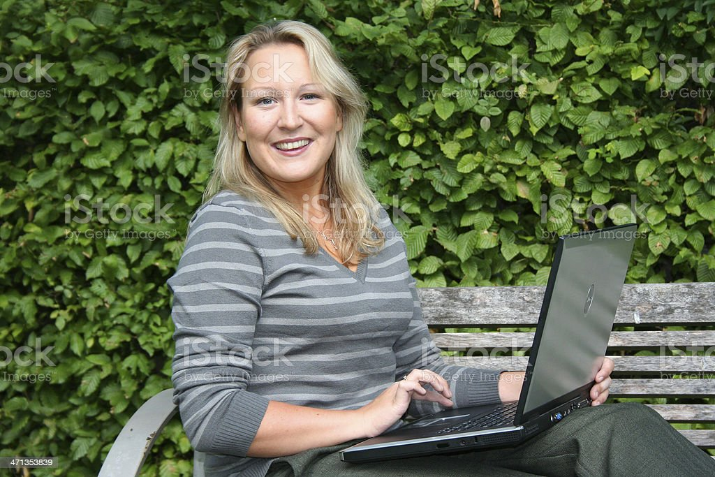 blond woman with laptop stock photo
