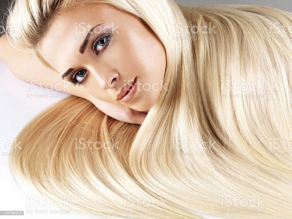 Blond woman with long straight hair royalty-free stock photo