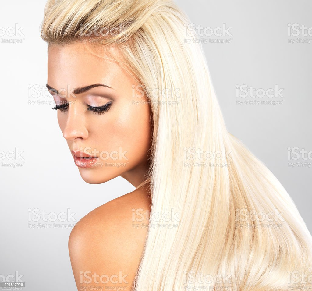 Blond woman with long straight hair stock photo