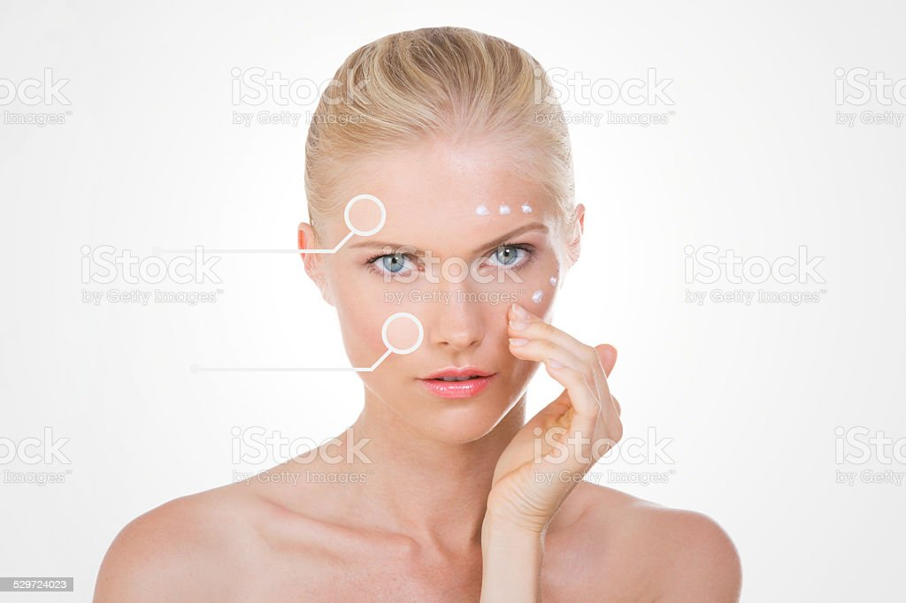 blond woman with points testing her salve stock photo