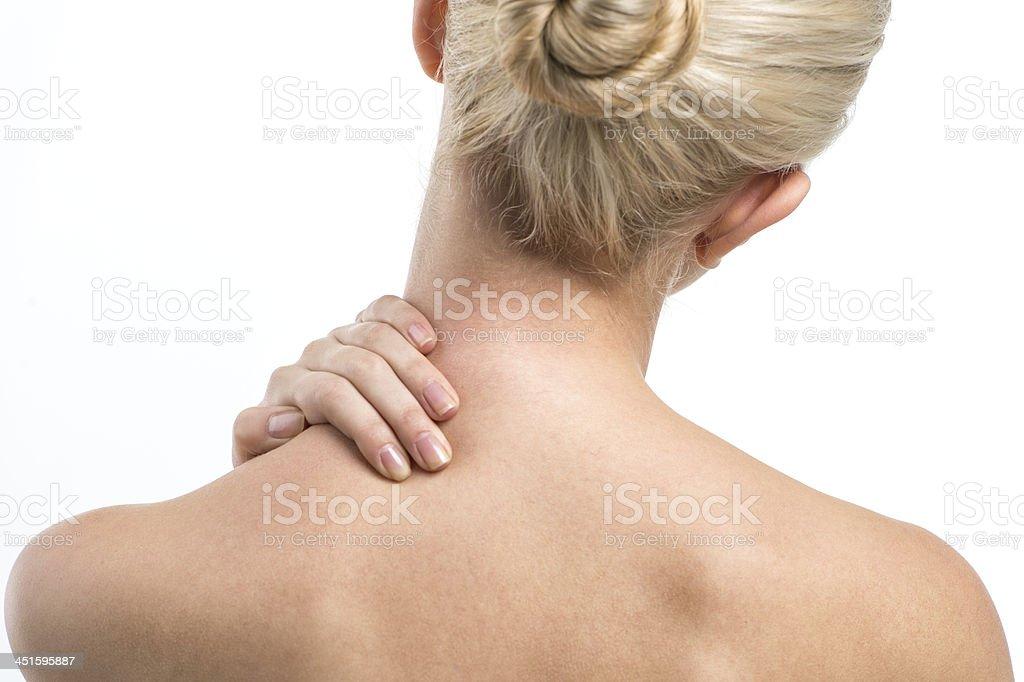 Blond women with neck ache. stock photo