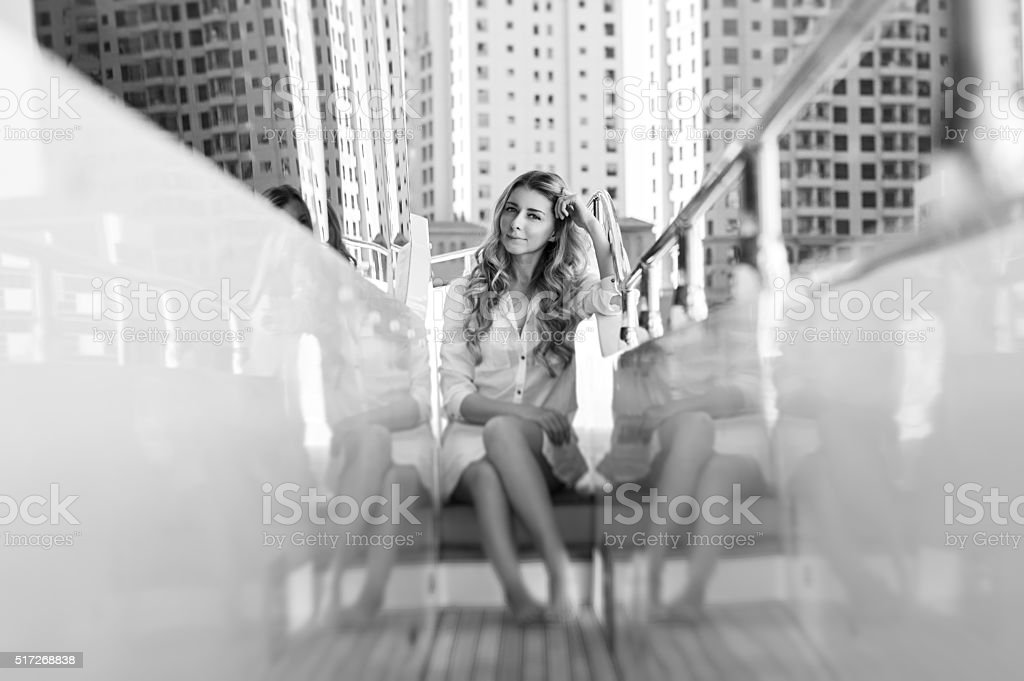blond young woman at the boat in Dubai stock photo