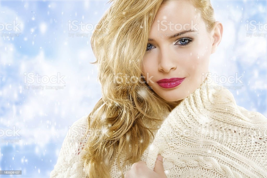 blond young woman standing in winter royalty-free stock photo