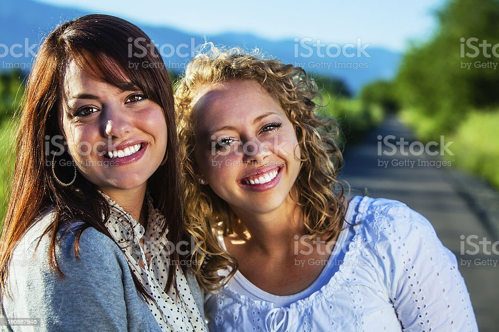 Blonde and Brunette Friends on the Road royalty-free stock photo