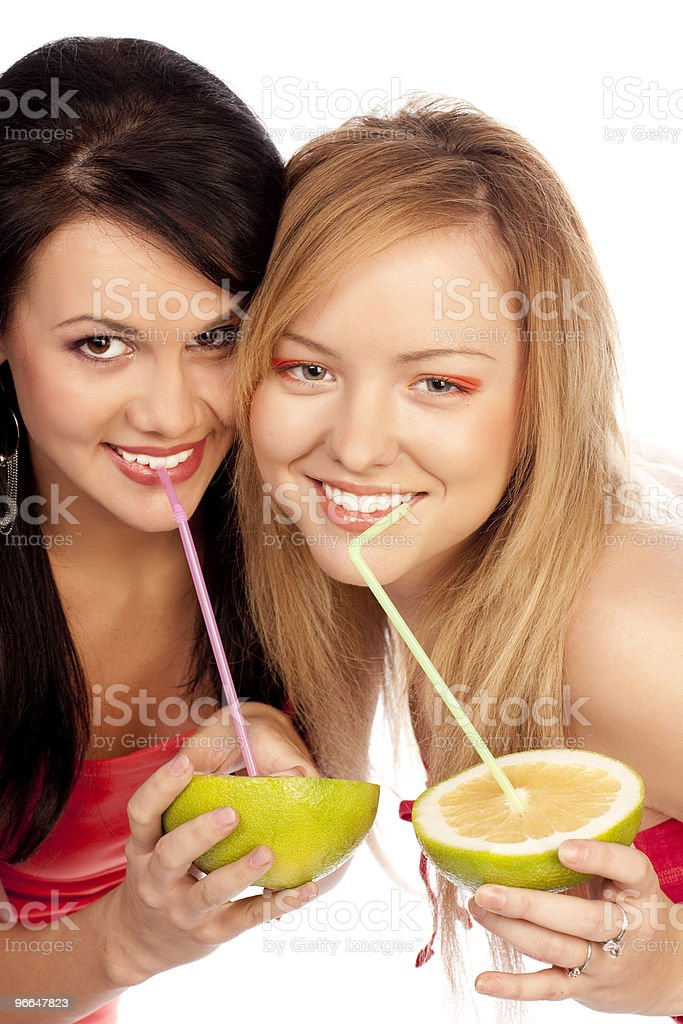 blonde and the brunette drink juice of citrus stock photo