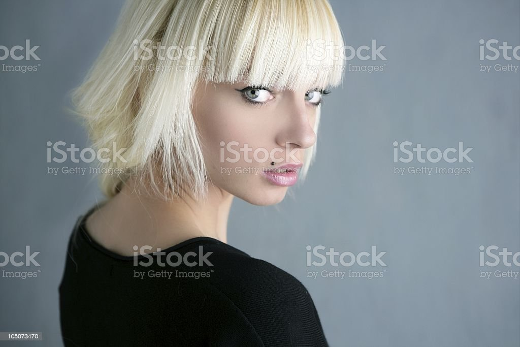 blonde beautiful fashion girl gray background stock photo