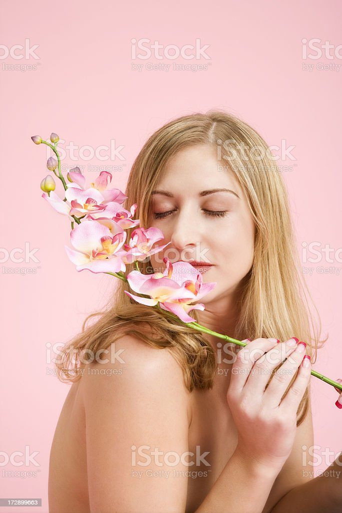 Blonde Beauty with Pink Orchids royalty-free stock photo