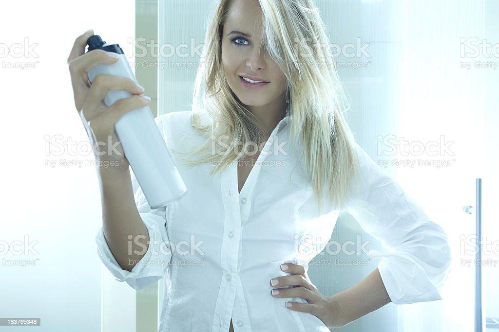 Blonde beauty with sprayer stock photo