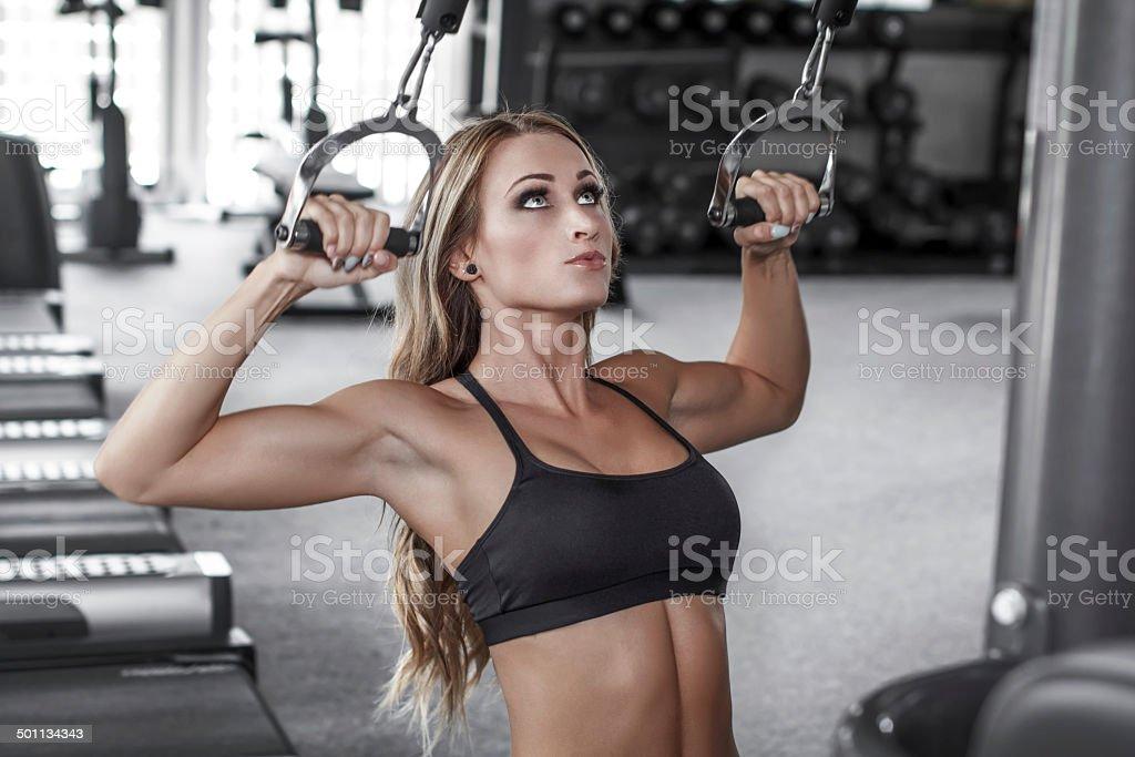 Blonde bodybuilder pulldown practice royalty-free stock photo