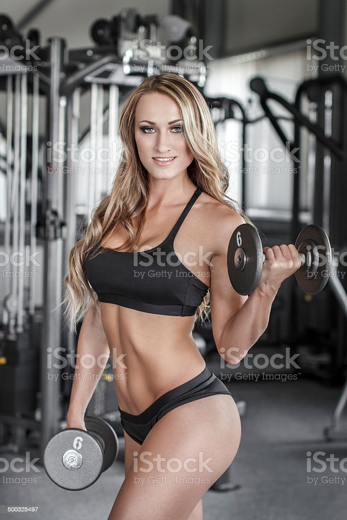 Blonde bodybuilder workout in gym royalty-free stock photo