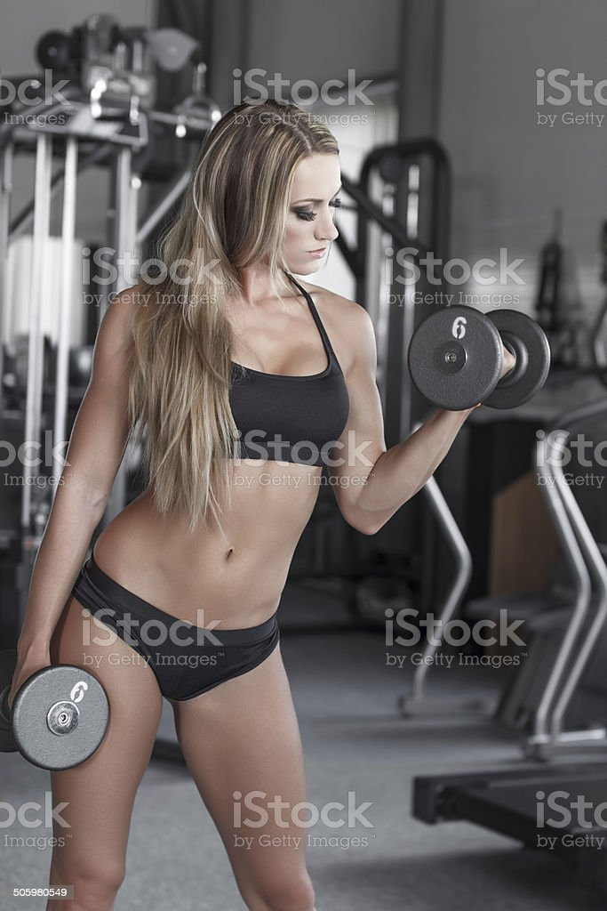 Blonde bodybuilder workout royalty-free stock photo