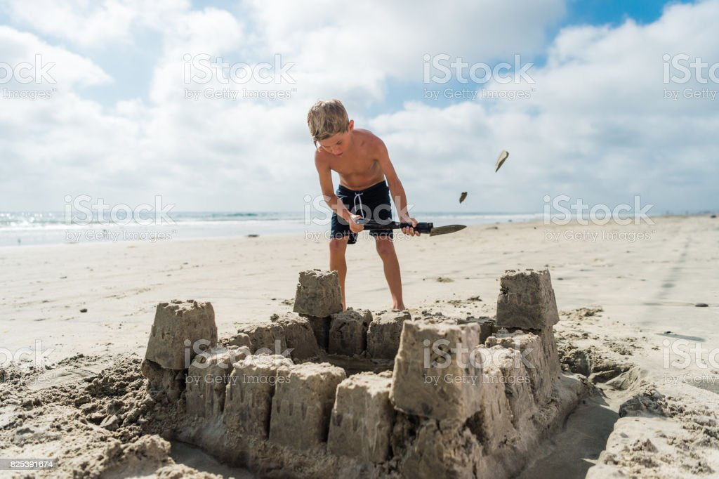 Blonde Boy At The Beach Building A Sand Castle royalty-free stock photo