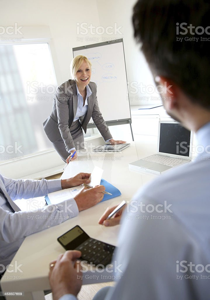 Blonde business woman making presentation in office royalty-free stock photo