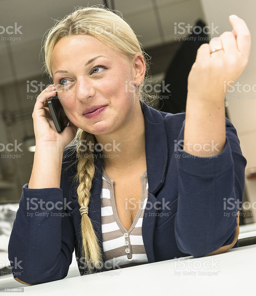 Blonde business woman on the phone royalty-free stock photo