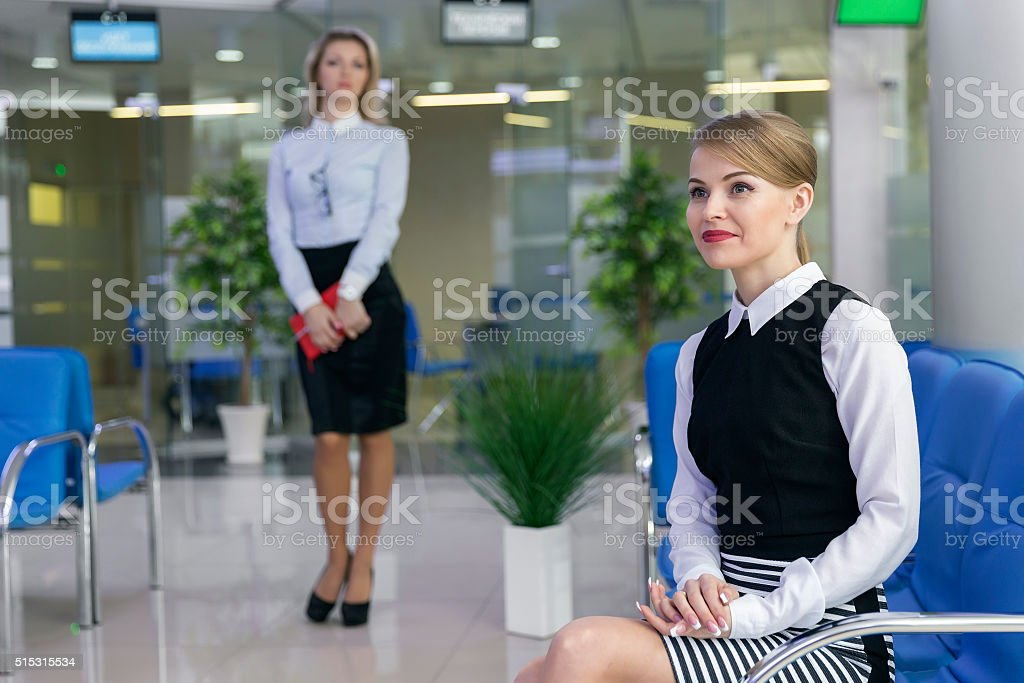 Blonde businesslike woman waiting in client service area stock photo