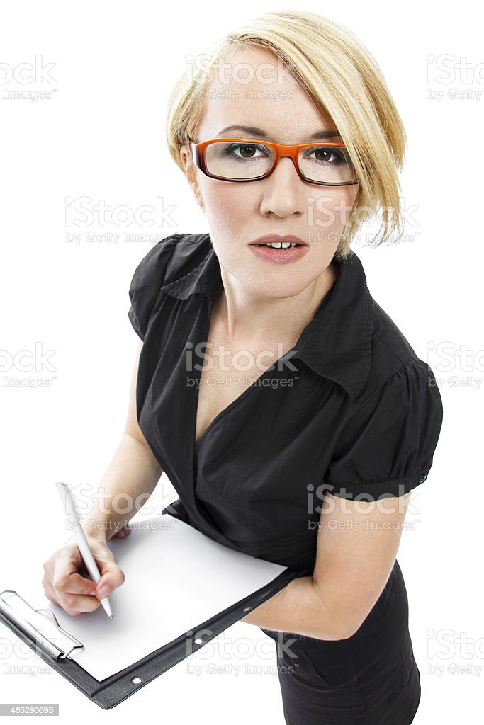 Blonde businesswoman with clipboard royalty-free stock photo