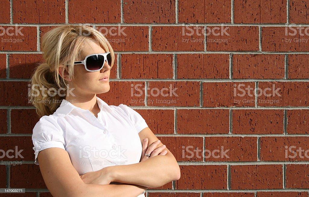 Blonde by bricks royalty-free stock photo
