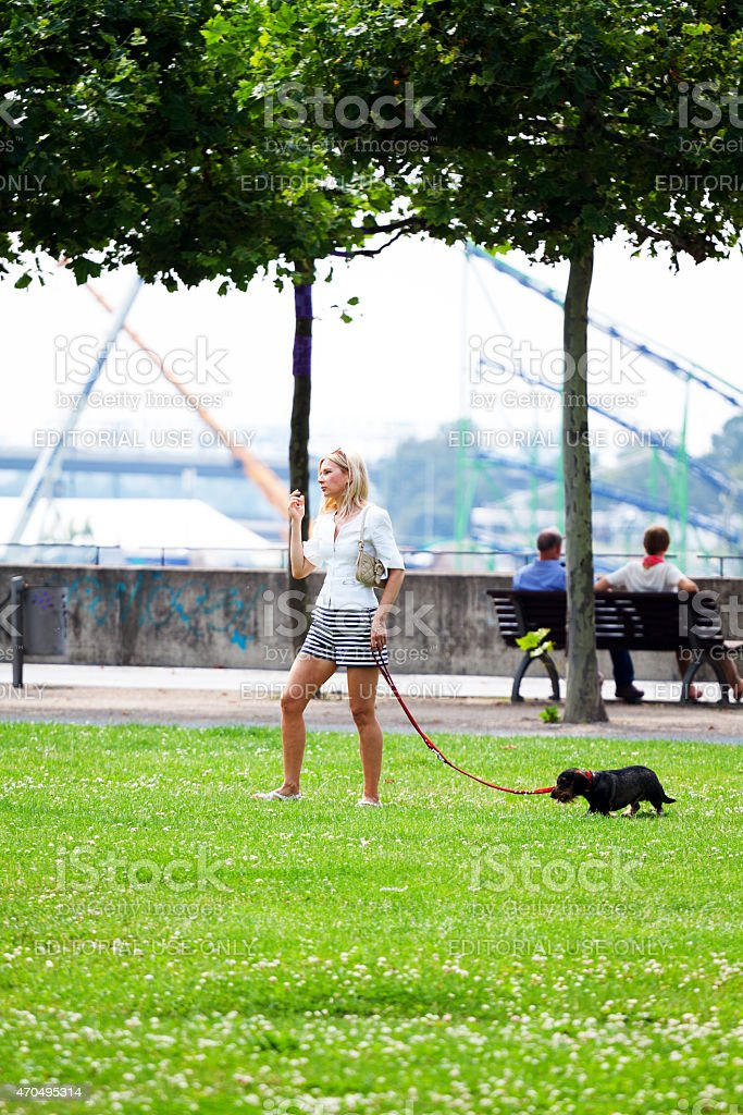 Blonde caucasian woman dogging at Rhine stock photo