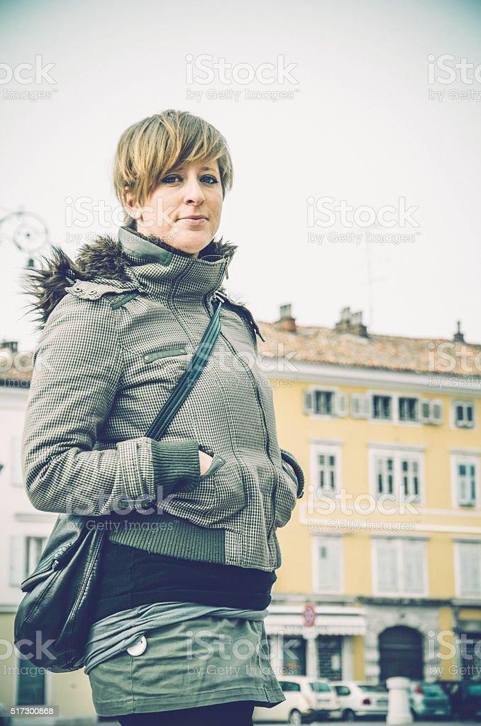 Blonde caucasian woman in the old city center, Gorizia Italy stock photo