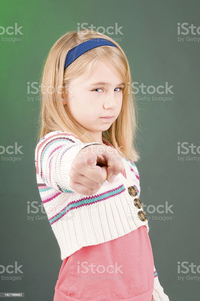 Blonde child pointing at the camera stock photo
