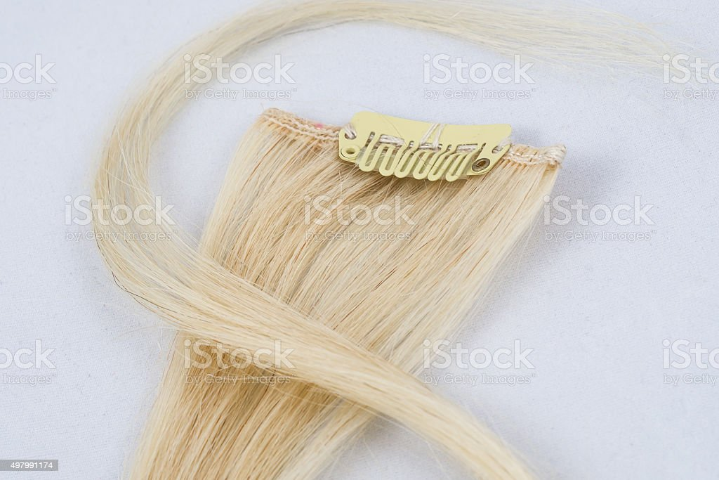 Blonde Clip-in extensions stock photo
