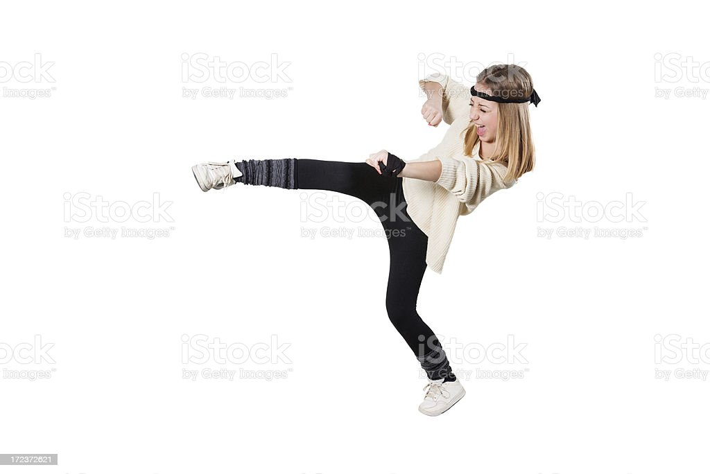 Blonde Cute Fitness Little Girl Kicking With the Leg royalty-free stock photo