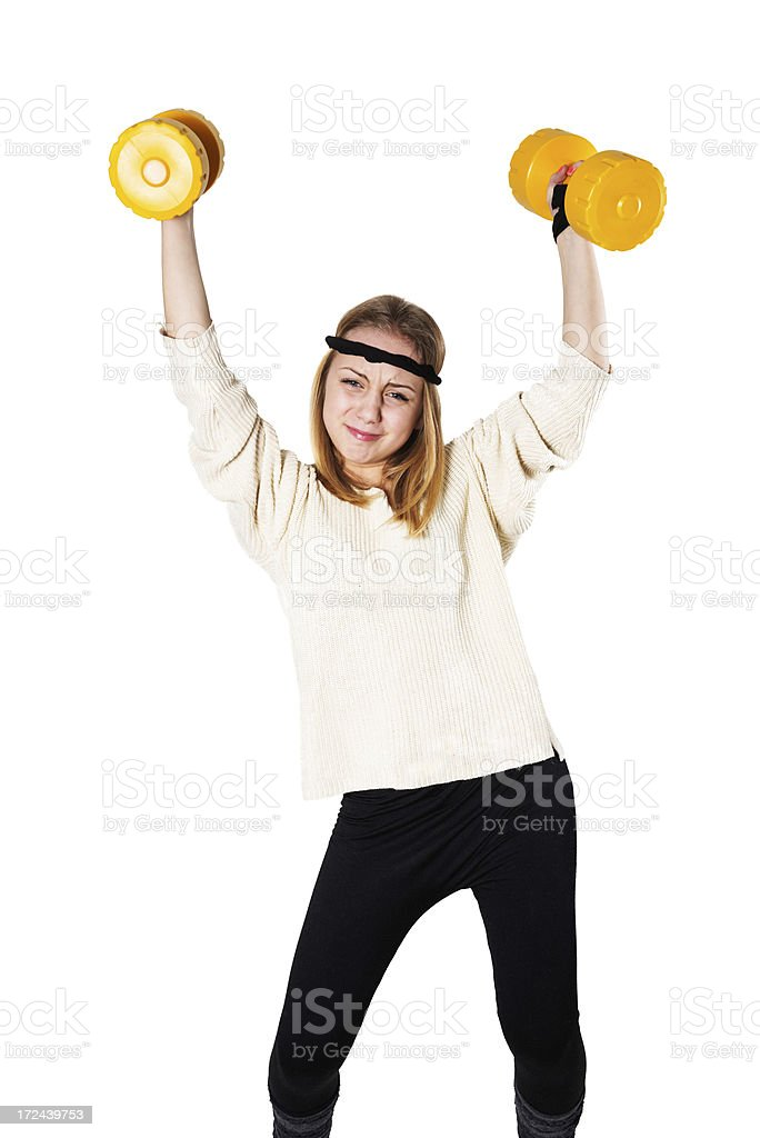 Blonde Cute Fitness Little Girl lifting hand weights royalty-free stock photo