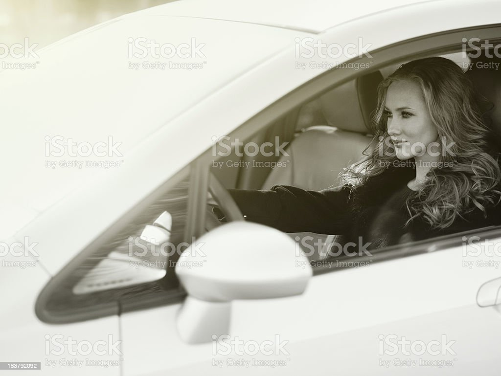 Blonde driving the car stock photo