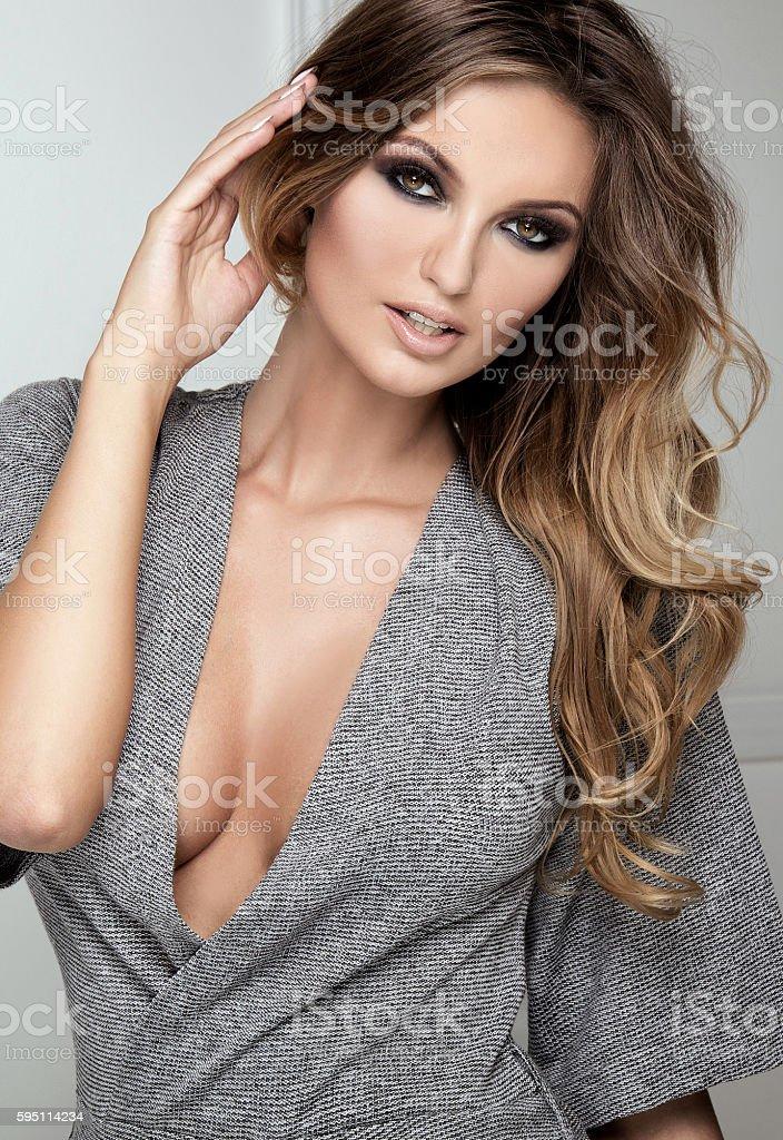 Blonde fashionable woman posing in studio. stock photo