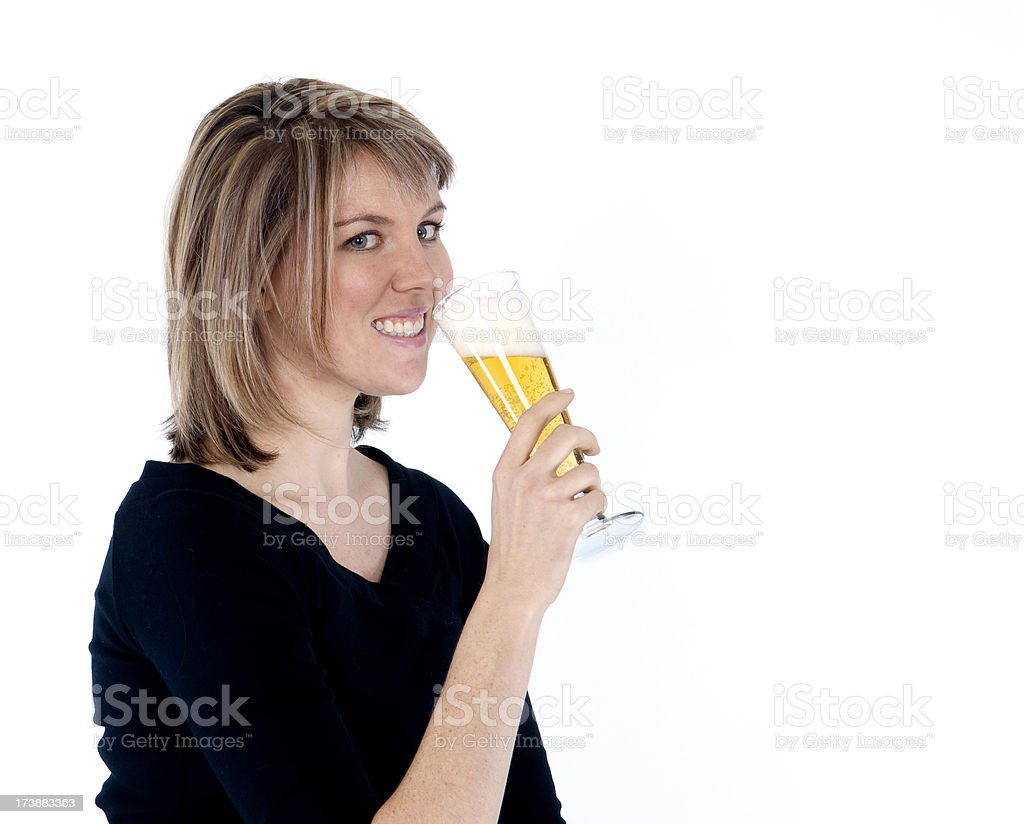 Blonde female dring a glass of beer stock photo