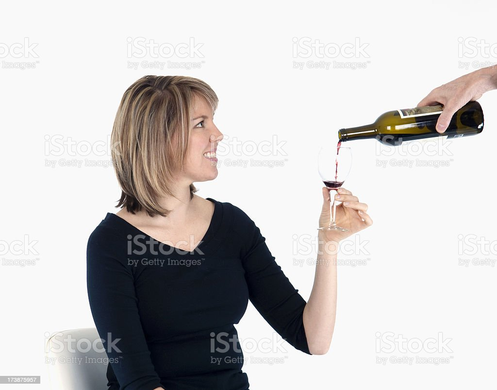Blonde female has wine glass filled stock photo