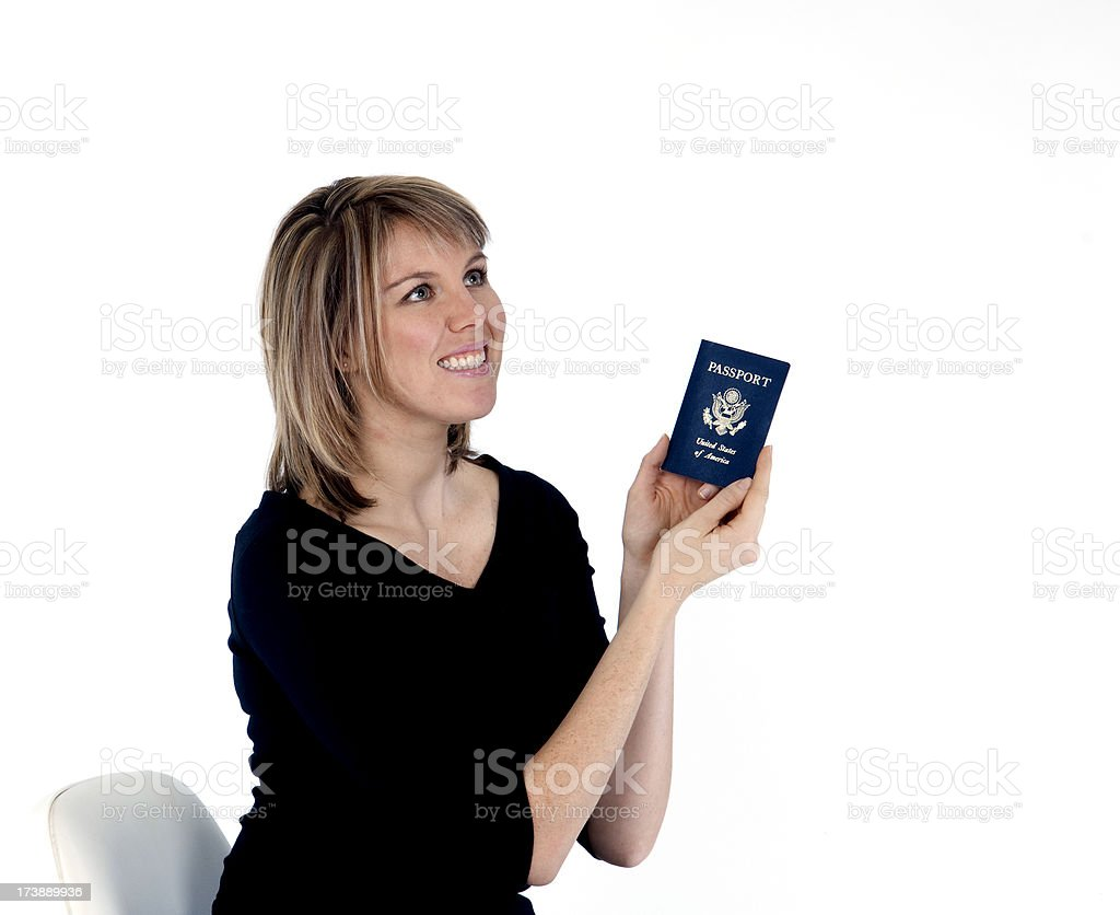 Blonde female holding passport dreaming of travels stock photo