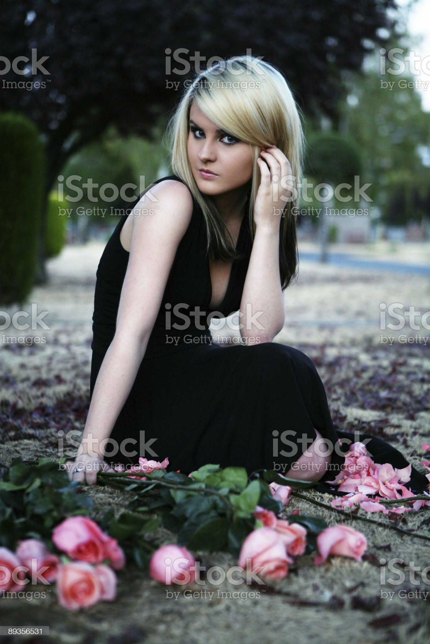 Blonde Female Sitting WIth Roses royalty-free stock photo