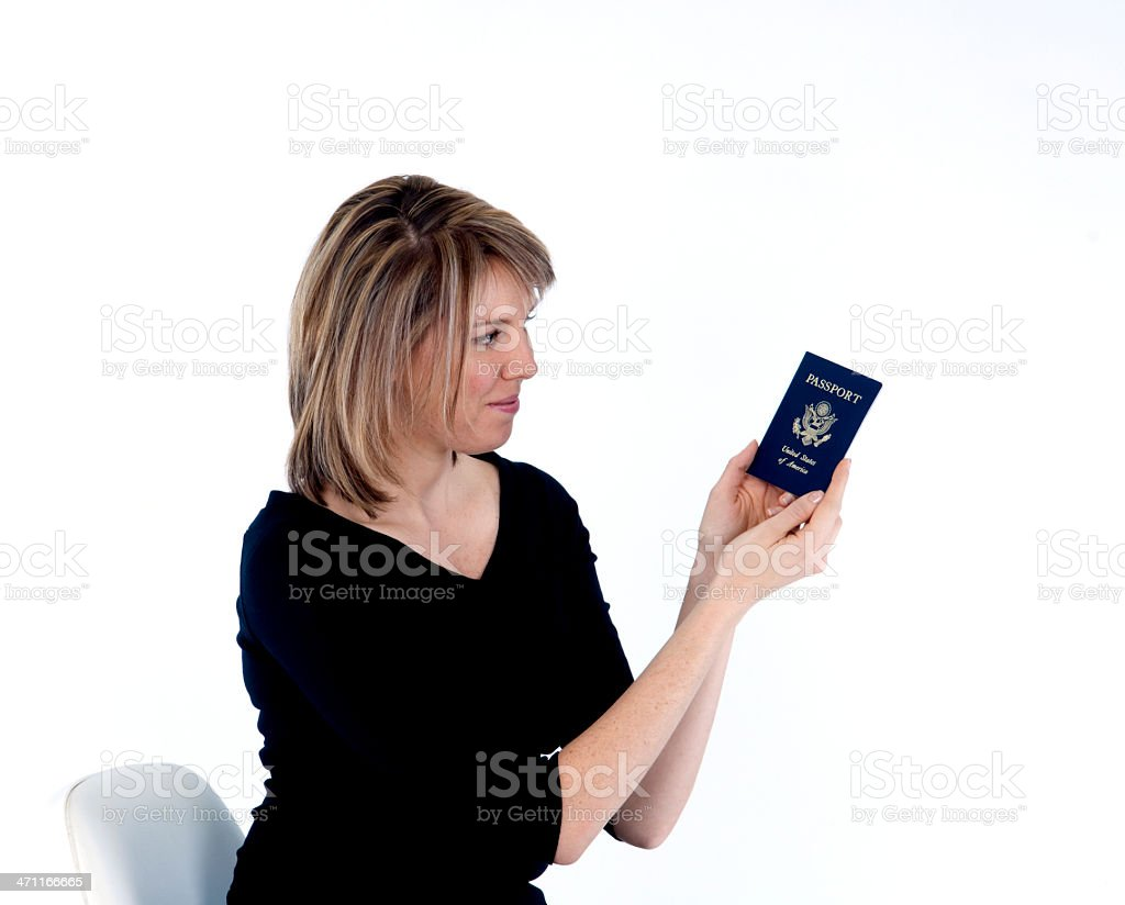 Blonde female with passport - profile stock photo