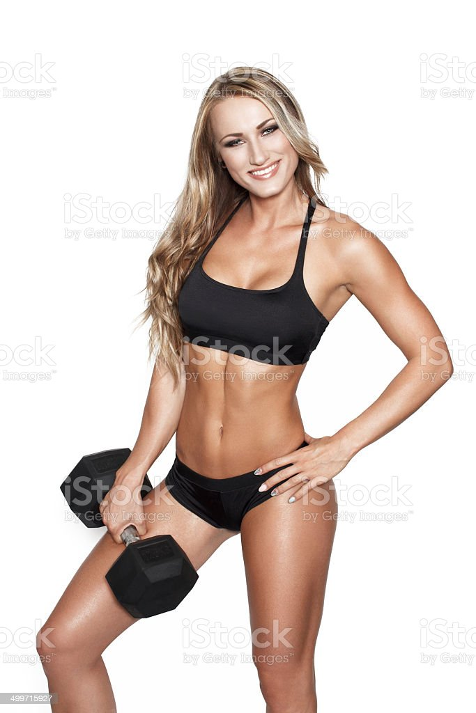 Blonde fitness model posing with dumbbell royalty-free stock photo