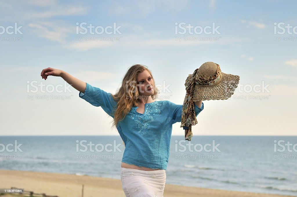 Blonde Girl By The Sea stock photo