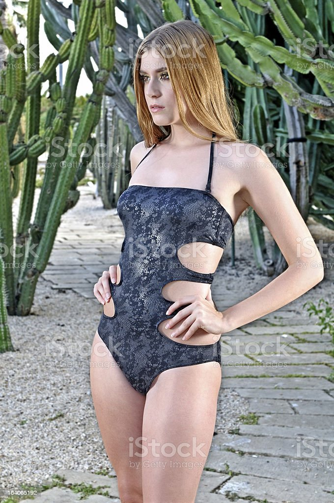Blonde girl dressed with black trikini stock photo
