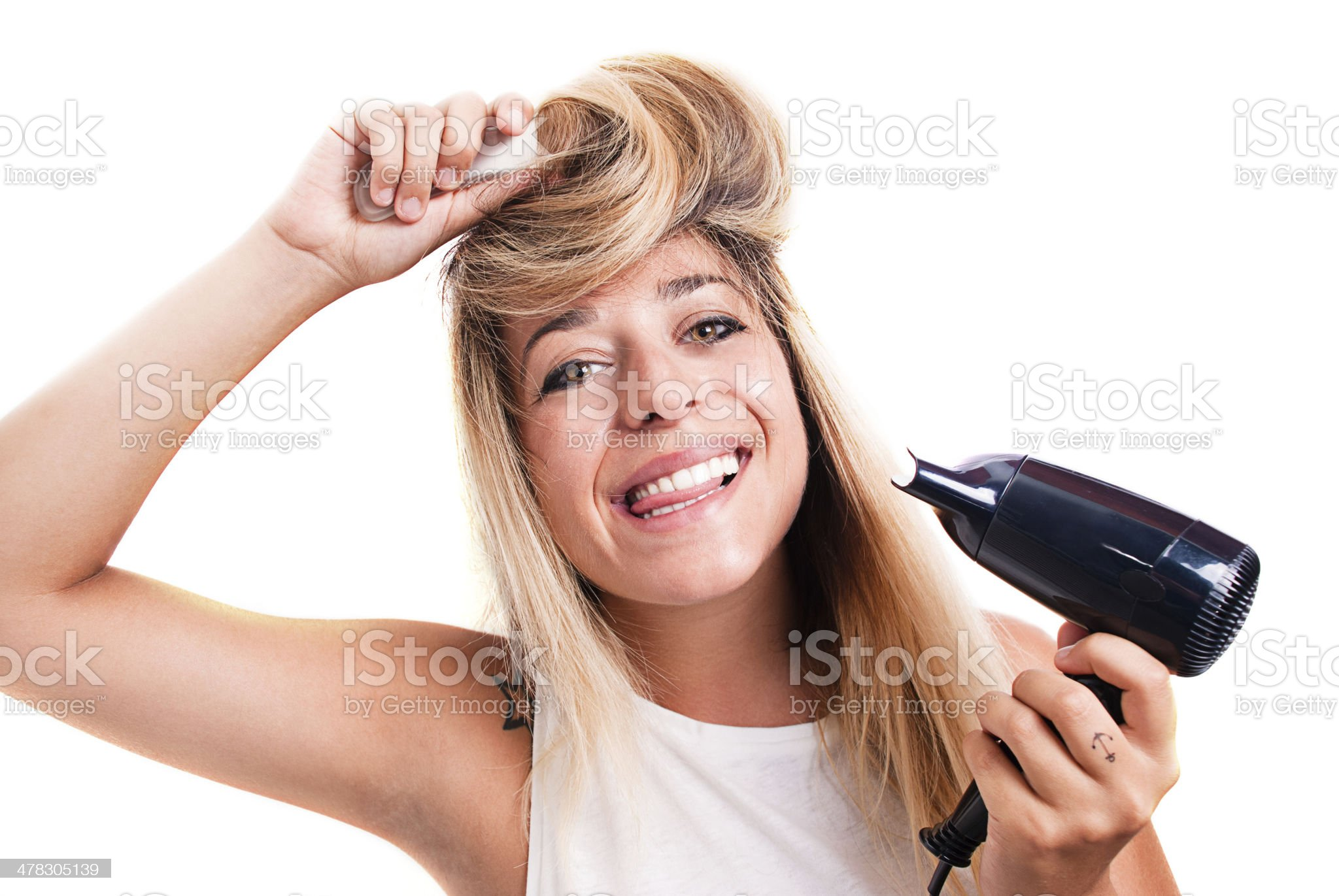Blonde girl dries her hair. royalty-free stock photo