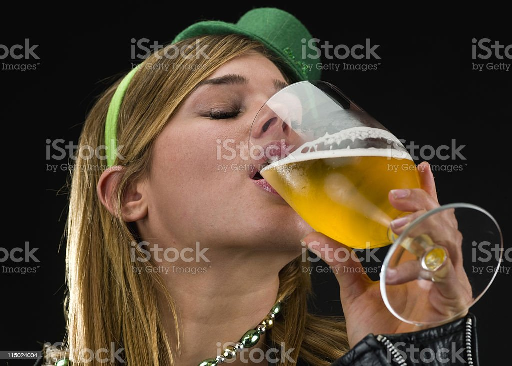 Blonde girl drinking beer royalty-free stock photo