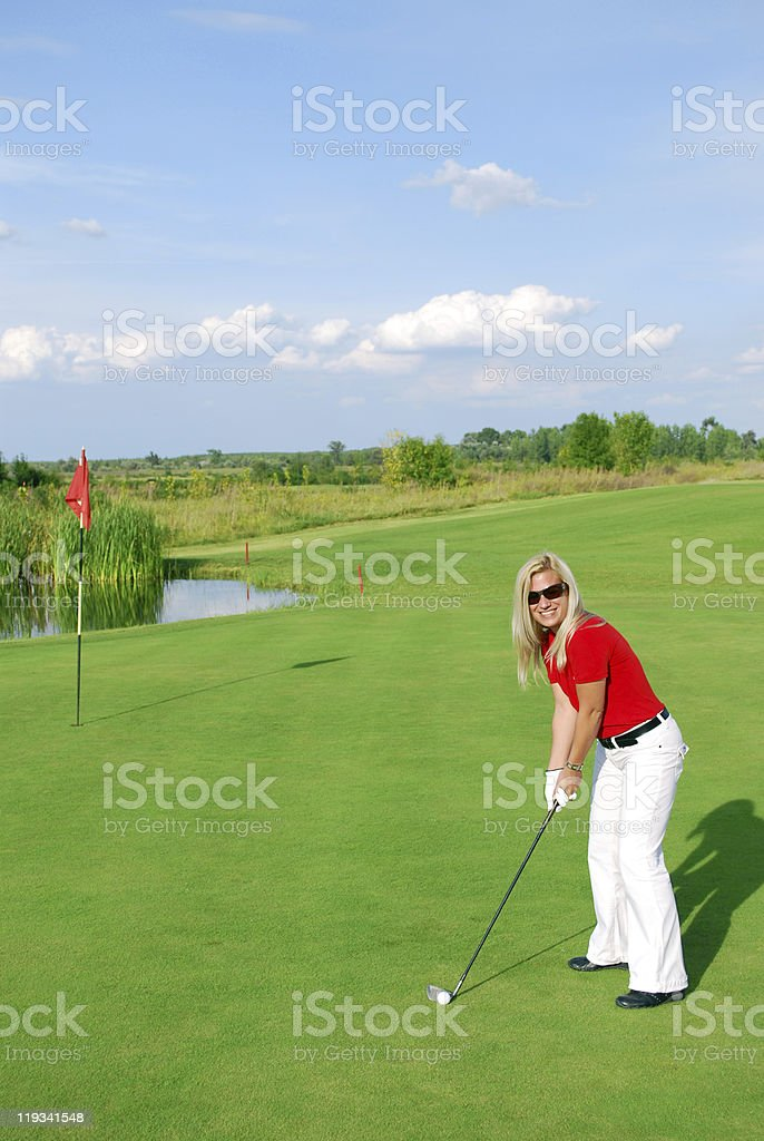 blonde girl golf player royalty-free stock photo