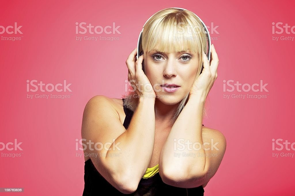 Blonde Girl Holding the Headphone on Her Head stock photo