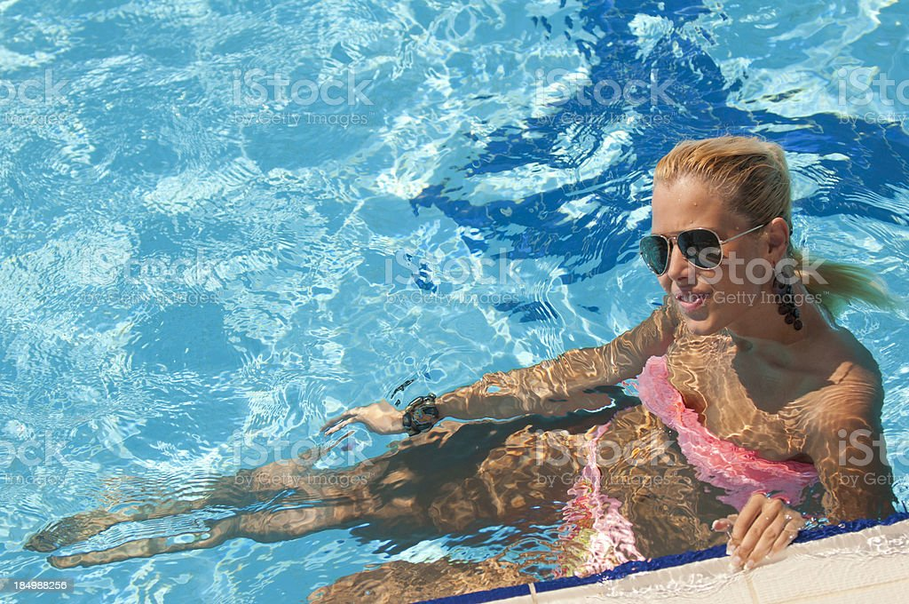 Blonde girl in a swimming pool royalty-free stock photo