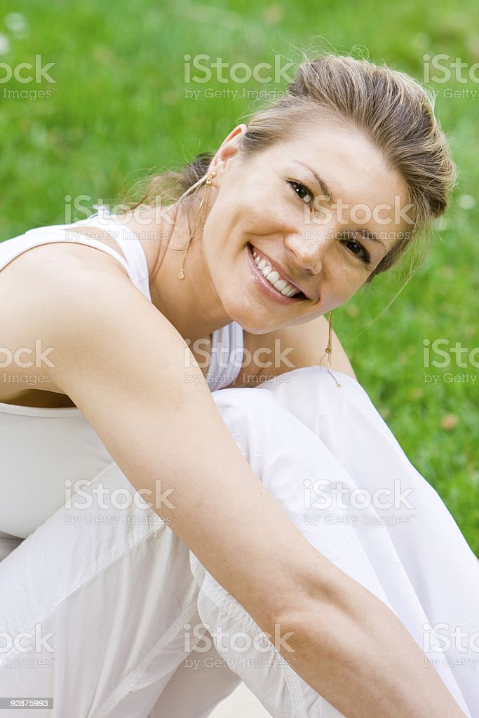 Blonde girl in park doing yoga royalty-free stock photo