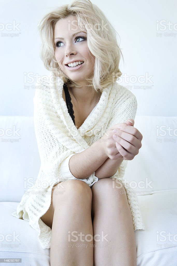 Blonde girl in sweater stock photo