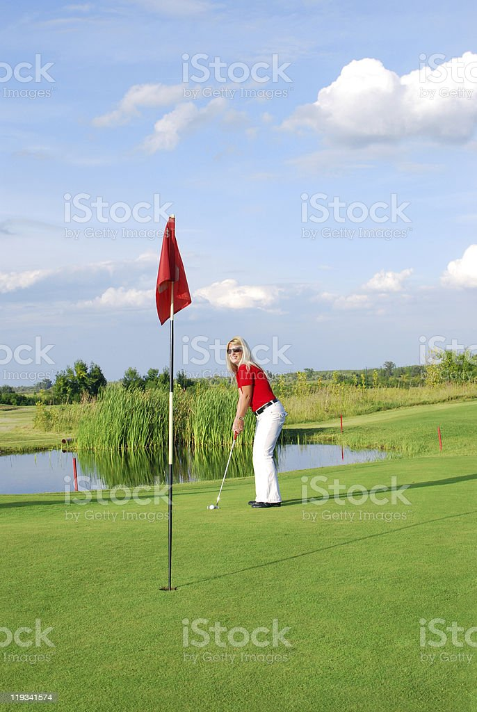 blonde girl playing golf royalty-free stock photo