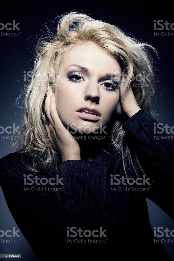 blonde girl portrait on dark background stock photo