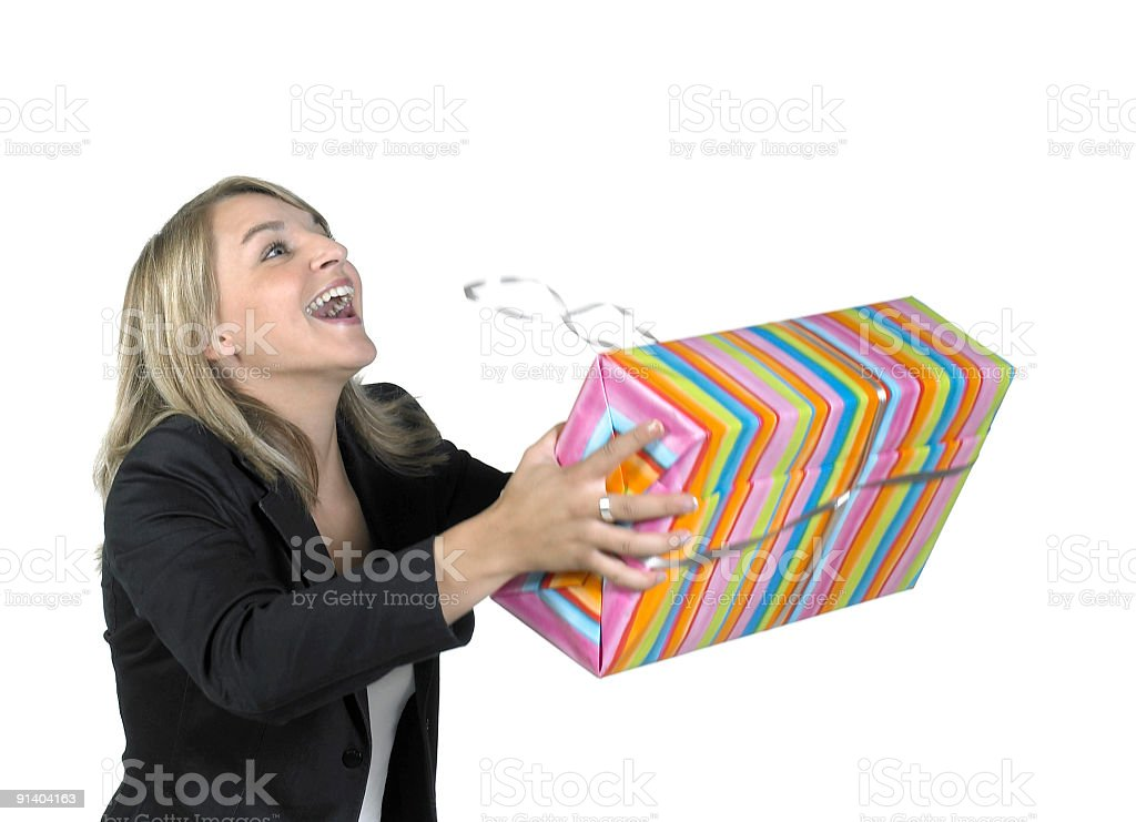 blonde girl recieving a present royalty-free stock photo